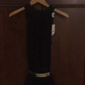 New York and company black jumpsuit. Tie neck
